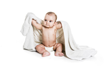 Baby boy portrait on white background with bath towel over his head