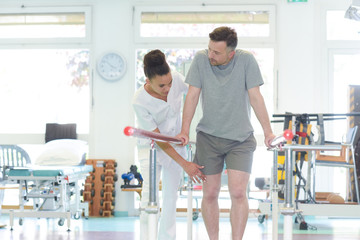 man rehabilitating his legs