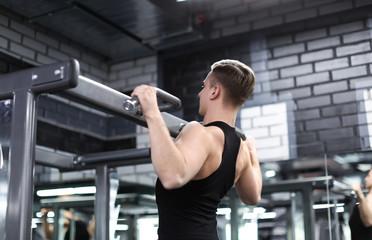 Athletic man training in modern gym