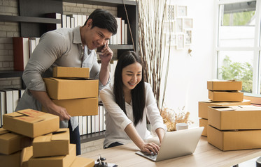 business digital online is small business a new start up in the present for online shop. By woman and man owner have a warehouse used to send to customer. SME entrepreneur concept