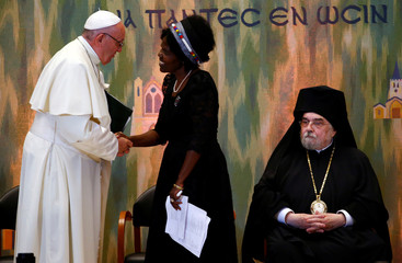 Pope Francis takes part in an ecumenical meetingat the World Council of Churches (WCC) in Geneva