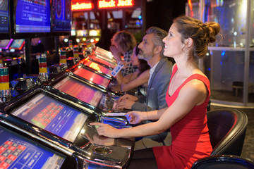 Woman playing machine in casino