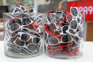 Sunglasses are seen on display at the American television news channel CNN stand on the beach at the Cannes Lions International Festival of Creativity, in Cannes