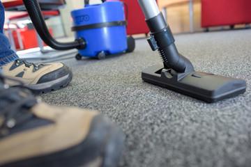 Closeup of feet and vacuum