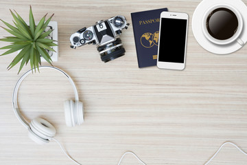 Top view of travel stuff on wood table with copy space