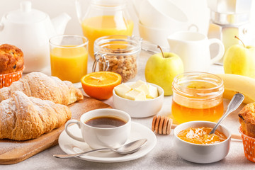 Continental breakfast with fresh croissants, orange juice and coffee