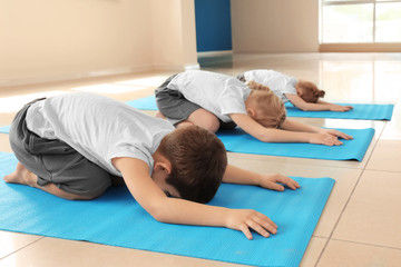 Poster Ontspanning Little children practicing yoga indoors