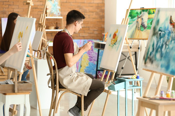 Male student during during classes in school of painters