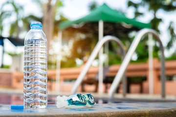 Water bottle  and goggles at swimming pool