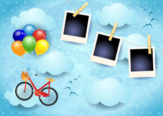 Surreal sky with balloons, bike and photo frames