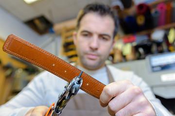 man making belts