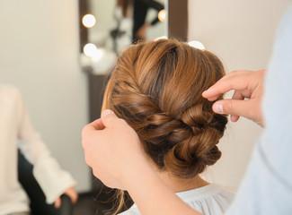 Foto op Aluminium Kapsalon Professional hairdresser working with client in beauty salon