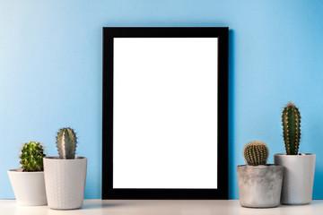 Black mockup frame with four cactuses on a blue background