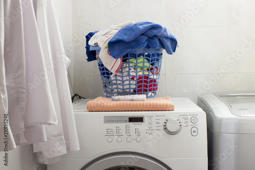 Little Laundry Area In A Domestic House There Are Two Clean White Shirts Hanged At