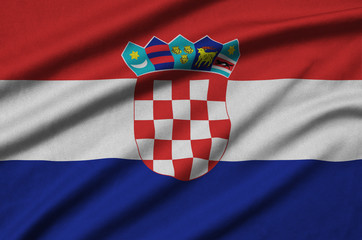 Croatia flag  is depicted on a sports cloth fabric with many folds. Sport team banner
