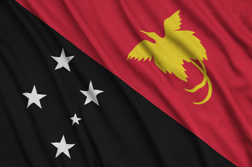 Papua New Guinea flag  is depicted on a sports cloth fabric with many folds. Sport team banner
