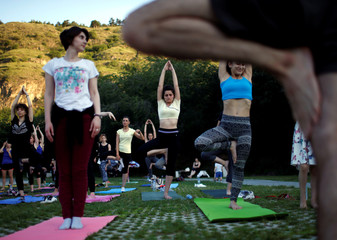 People perform yoga on International Yoga Day in Tbilisi