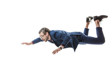 Fototapeta businessman in suit and eyeglasses flying and looking away isolated on white