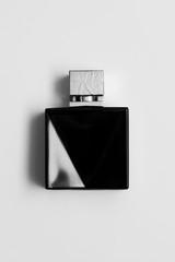 black perfume bottle isolated on white.