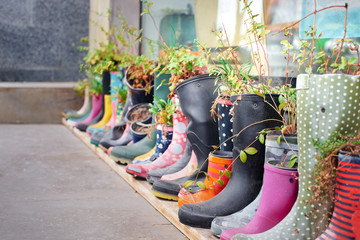 Creative flower decoration set in old rubber boots Wall mural