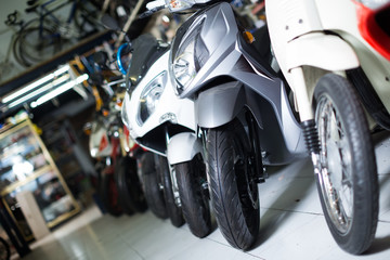 Image of modern different colors motorbikes in the shop