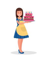 The hostess holds a beautiful cake.