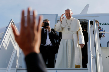 Pope Francis waves to Swiss President Alain Berset at the end of his visit in Geneva
