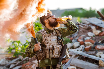 Happy Soldier Celebrating. Soldier drink beer.