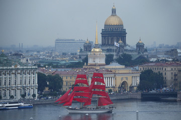 Sweden's brig Tre Kronor with scarlet sails floats on the Neva River past the Admiralty building and St. Isaac's Cathedral during a rehearsal for the festivities marking school graduation in St. Petersburg