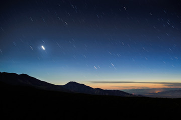 sunset star trail in the mountains