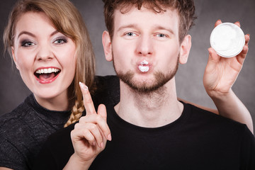 Funny couple playing with cream.