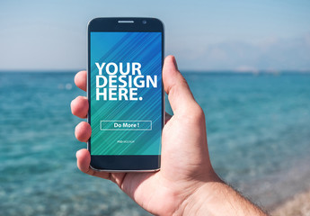 Hand Holding Smartphone At Beach Mockup
