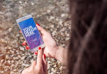 Hands Holding Smartphone in a Natural Landscape Mockup