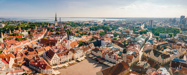 Foto op Canvas Luchtfoto Amazing aerial view of the Tallinn old town with many old houses sea and castle on the horizon.