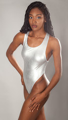 Attractive Woman in Metallic Silver One Piece Bathing Suit