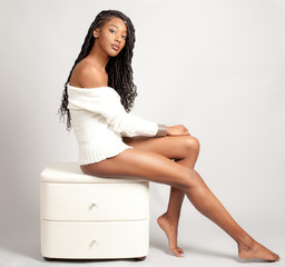 Beautiful Woman in White Sweater Sitting on White Set of Drawers