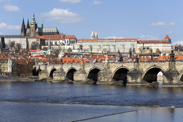 Spring Prague gothic Castle and Charles Bridge with the Lesser Town in the sunny Day, Czech Republic