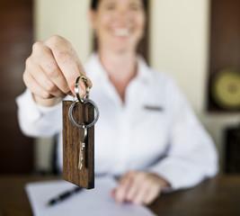Receptionist handing over the room key