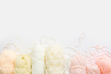 Wool and cotton yarn for knitting of neutral natural color. Background white.
