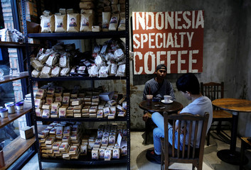 Bags of Indonesian roasted coffee are seen for sale at an Anomali Coffee shop in Jakarta