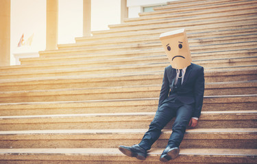 Businessman masked stress on the company stairs. Wall mural