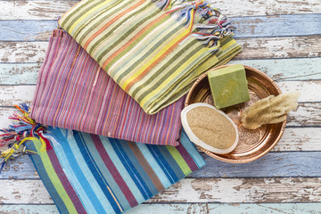 Turkish bath set with peshtemals, sponge, natural soap, and scrubber brush