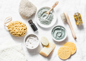 Wall Murals Spa Spa accessories - nut scrub, sponge, facial brush, natural soap, clay face mask, pumice stone, essential oil on a light background, top view. Healthy lifestyle concept. Beauty, skin care. flat lay