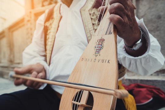 Man Plays Croatian Musical Instrument in Dubrovnik