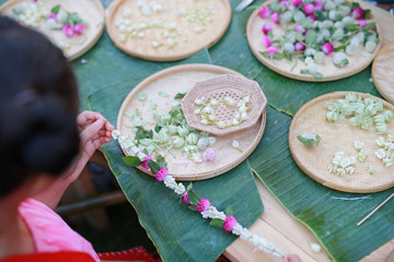Close-up garland handmade of flowers used for special occasion day in Thailand.