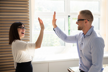 Businessman Giving High Five To His Colleague