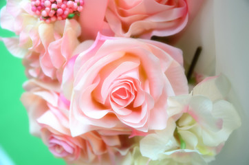 Artificial rose made by satin.Wedding decoration. Tone effected.
