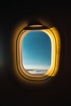 Airplane window in sunlight