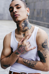 Trendy hipster with colorful tattoos