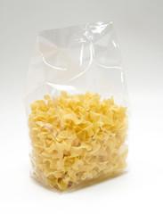 "Transparent plastic pasta bag ""tagliatelle girate."" on white background"